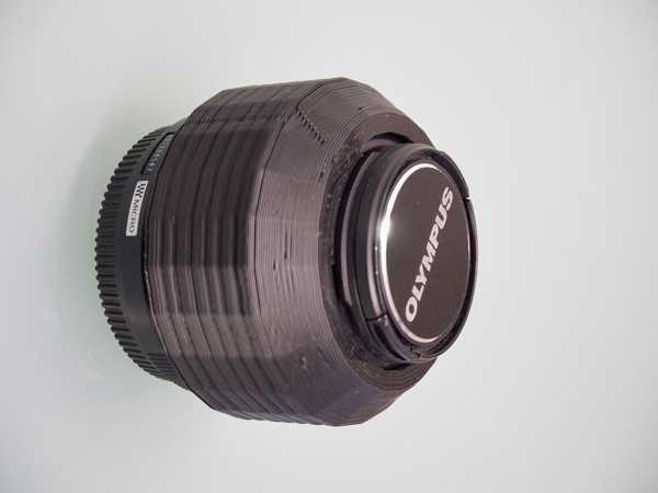Olympus 45mm f / 1.8 lens için ters çevrilebilir parasoley.